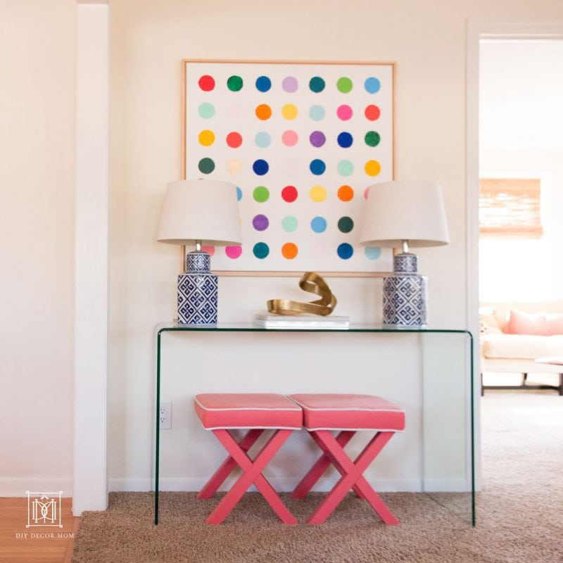 glass console table with pink stools abstract art and pink stools | console table decor