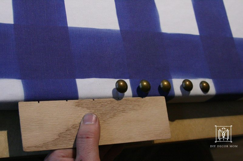 measuing nailhead trim for DIY fabric covered bulletin board