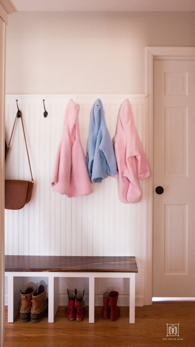 small entrance mudroom in narrow hallway with coat hooks beadboard and mudroom bench diy