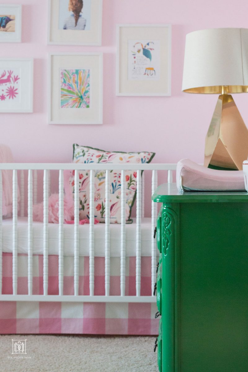 light pink little girls shared bedroom with pink buffalo check crib in benjamin moore romantic pink nursery