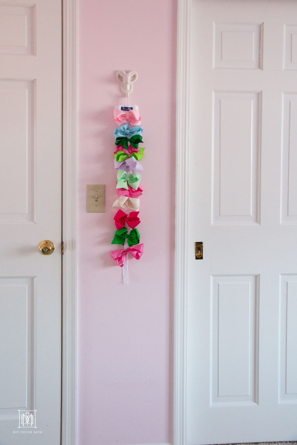 bow ribbon in light pink shared girls bedroom nursery