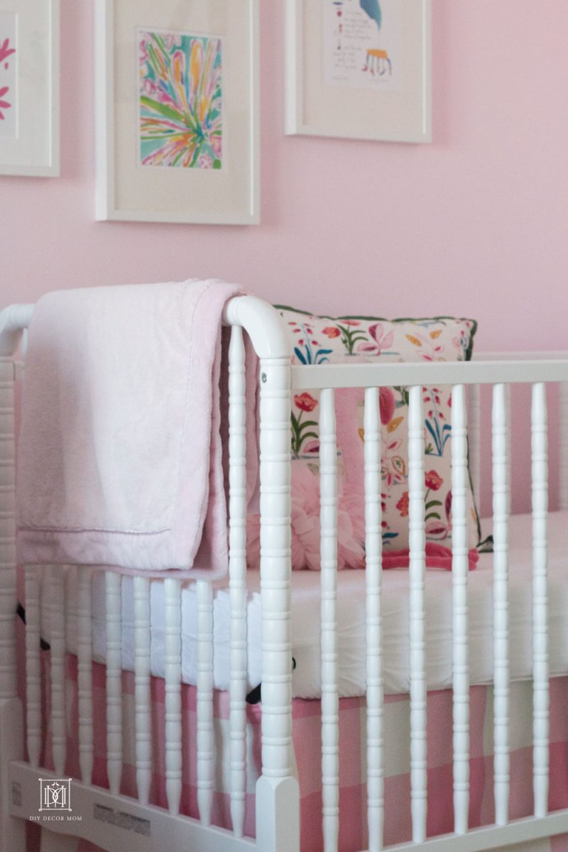 little girls shared bedroom with crib
