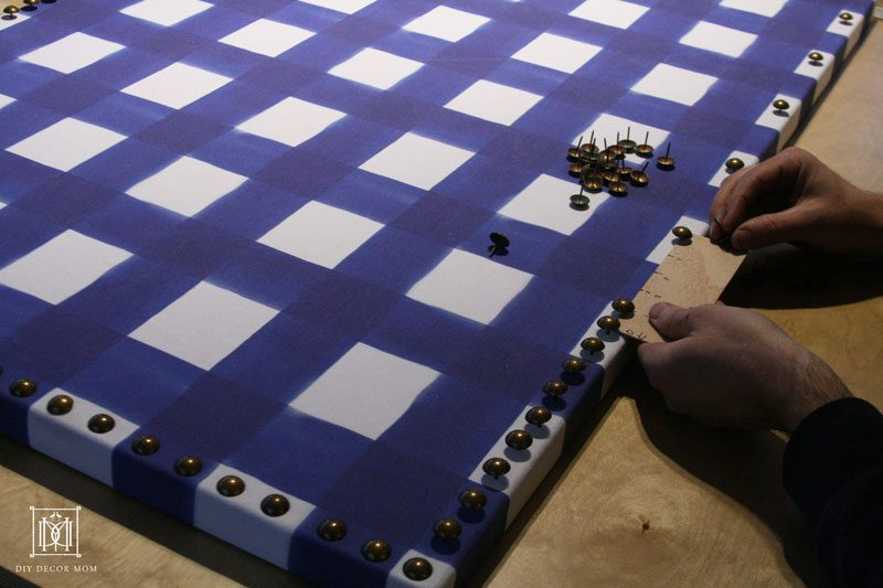 Nailhead trim for fabric bulletin board