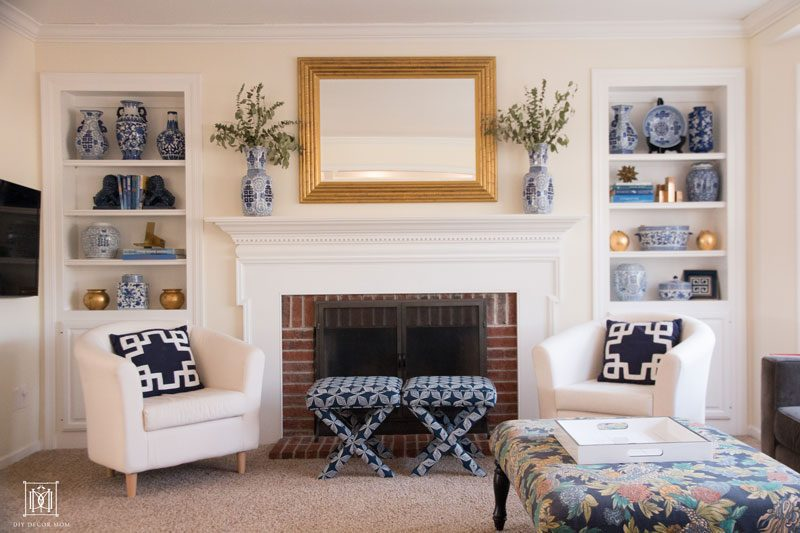 blue and white mantel with blue and white ginger jars and gold faux bamboo mirror