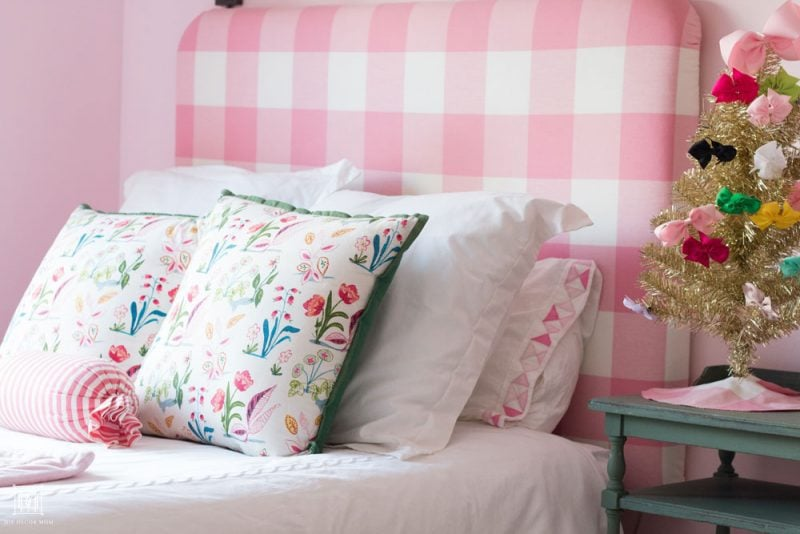 shared girls bedroom double bed with upholstered pink buffalo check DIY headboard