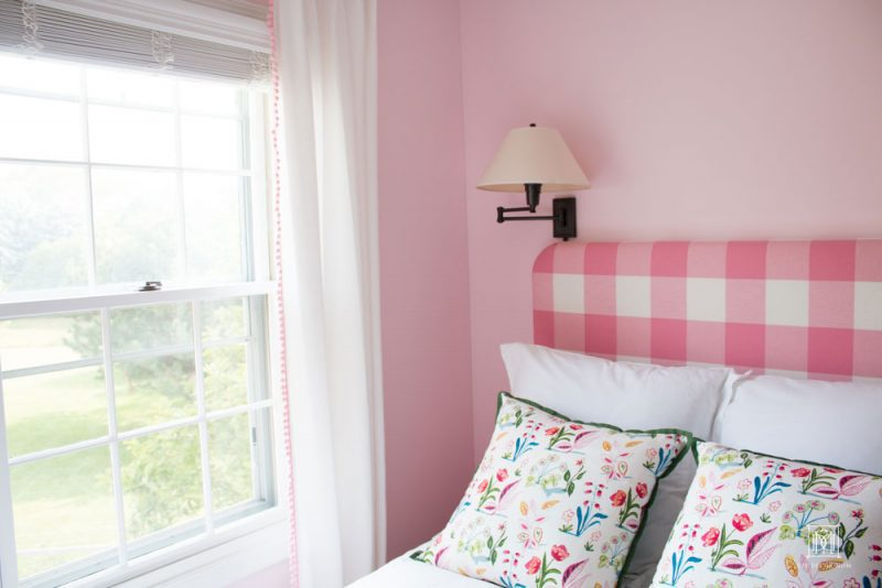 shared girls room headboard pink buffalo check with white curtains and light pink wall colro