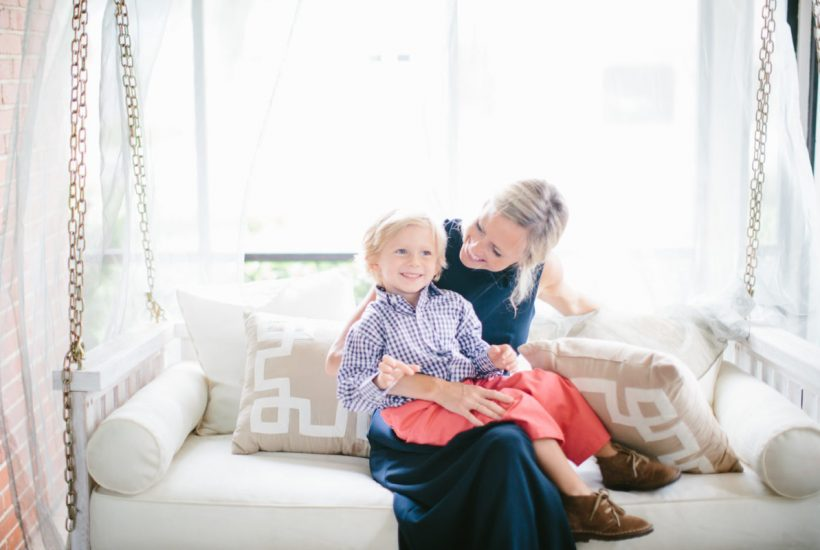 tips for decorating with kids- sarah tucker and son sitting on light colored couch