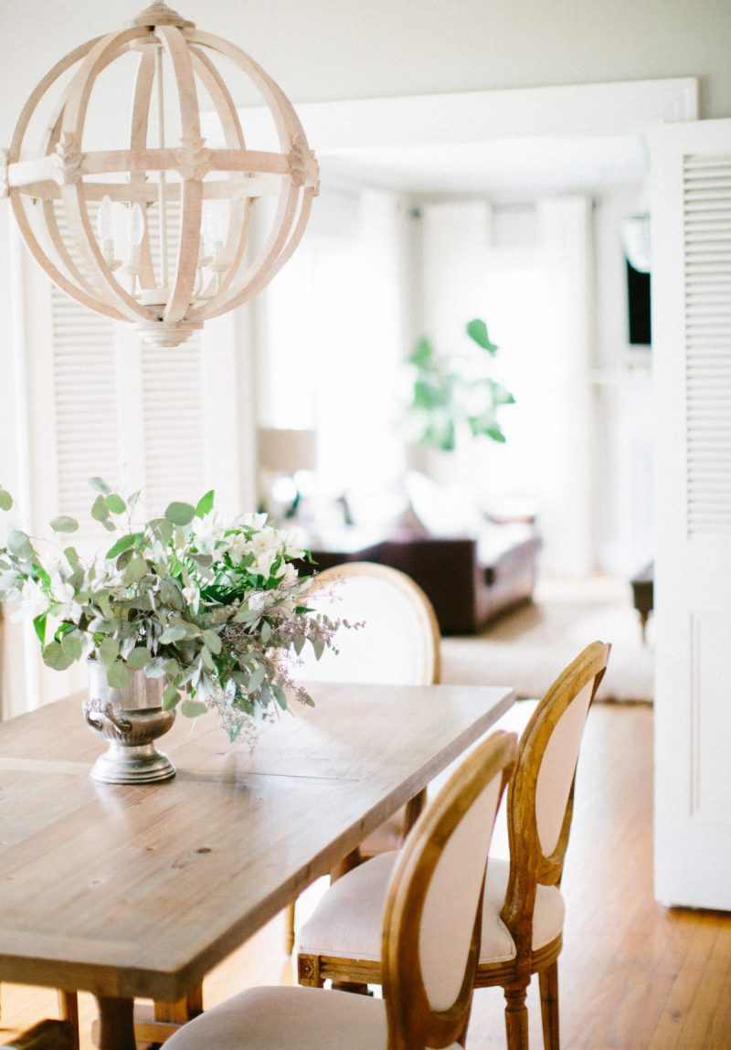 how to design a home with kids- farmhouse table and chairs wooden bead chandelier