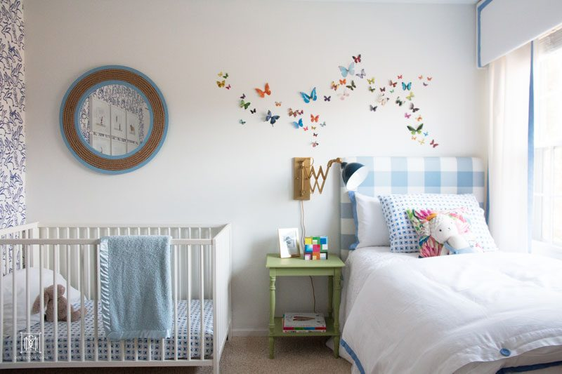 nursery decor boy- blue buffalo check headboard, french blue accents and crib in boy nursery