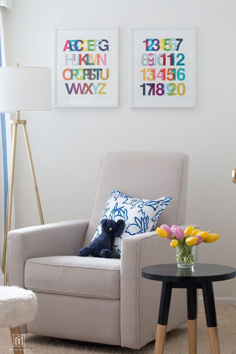baby boy nursery decor ideas- whites and navy accents with rocking chair
