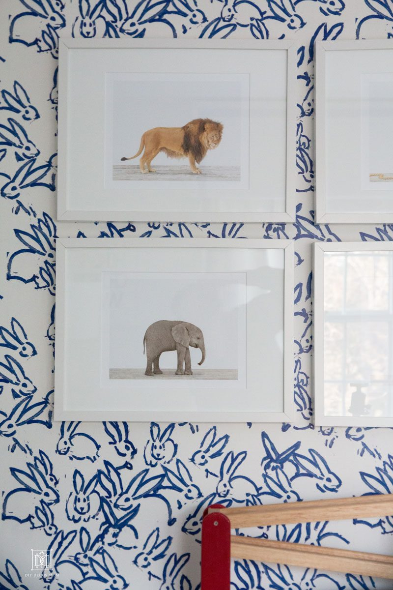 blue and white wallpaper accent wall in baby boy nursery