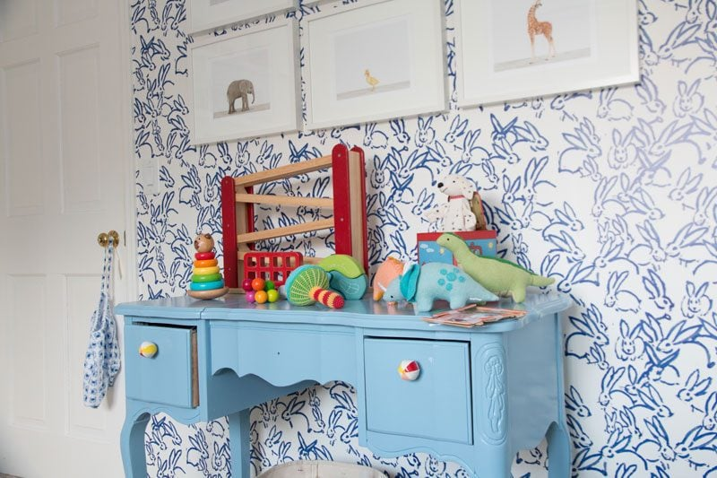 blue and white bunny wallpaper in baby boy room