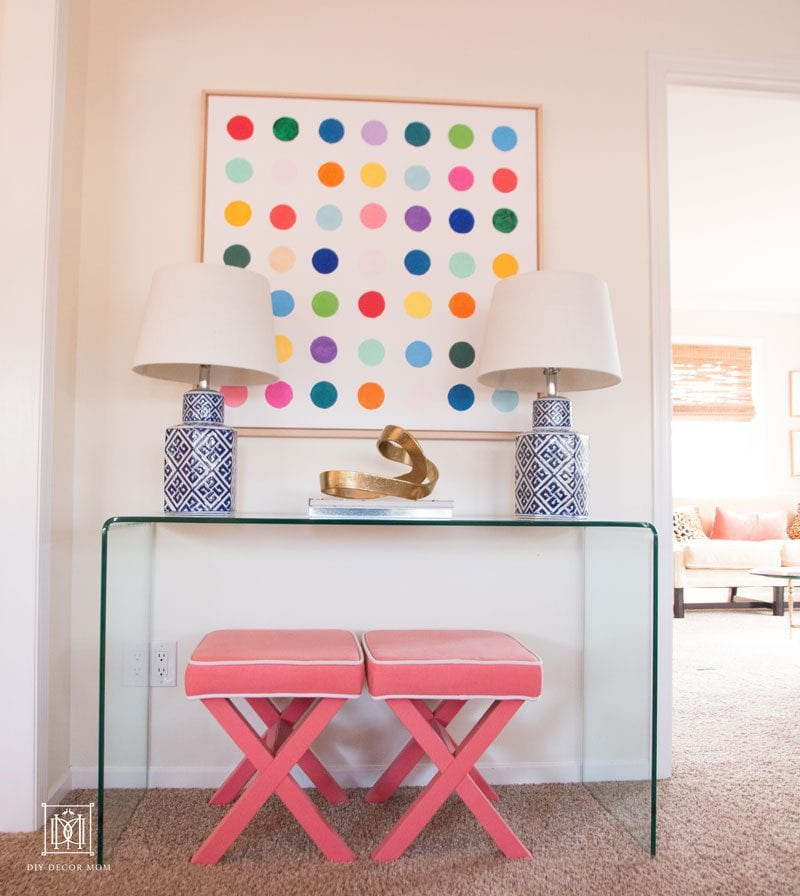 SUCH cute modern diy wall art in living room! white large canvas with wood frame and multicolored polka dots