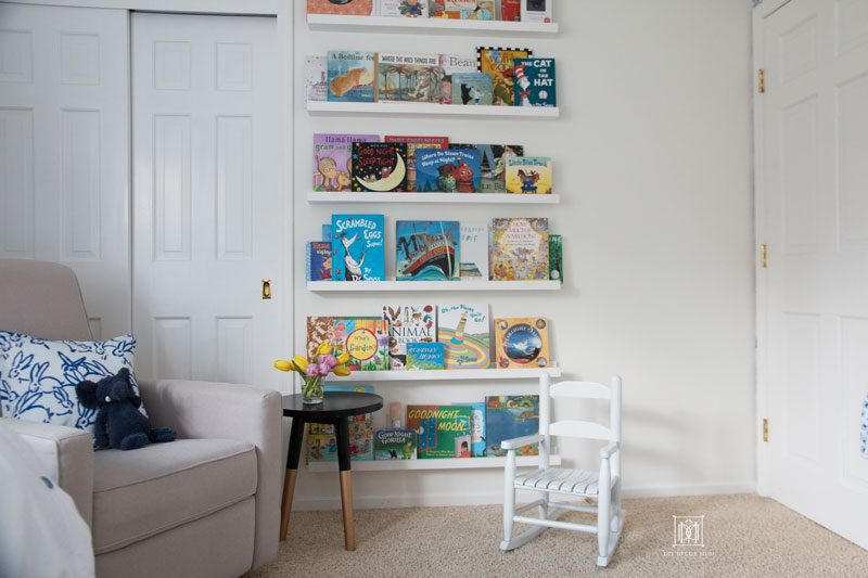 white wall nursery with DIY bookcase DIY bookledge with chair and rocking chair
