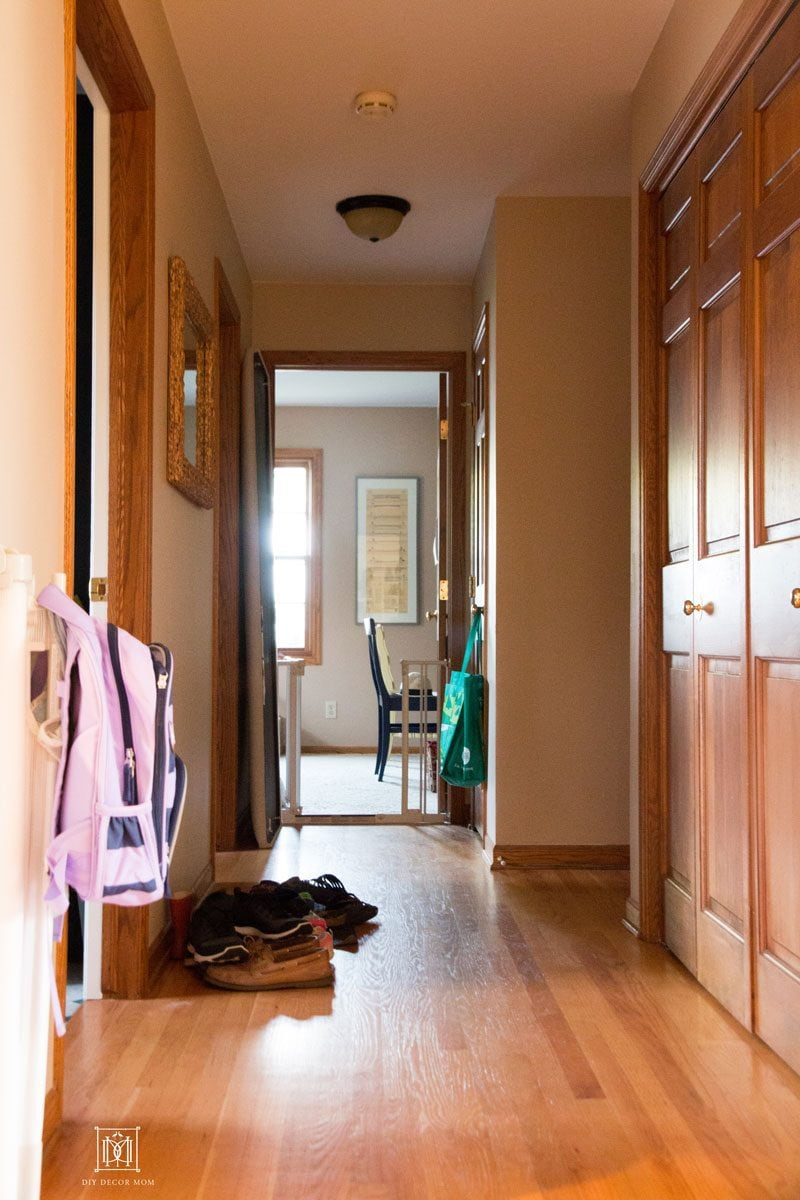 dark narrow hallway mudroom before
