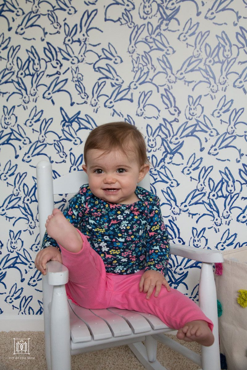 blue and white accent wall in nursery baby girl