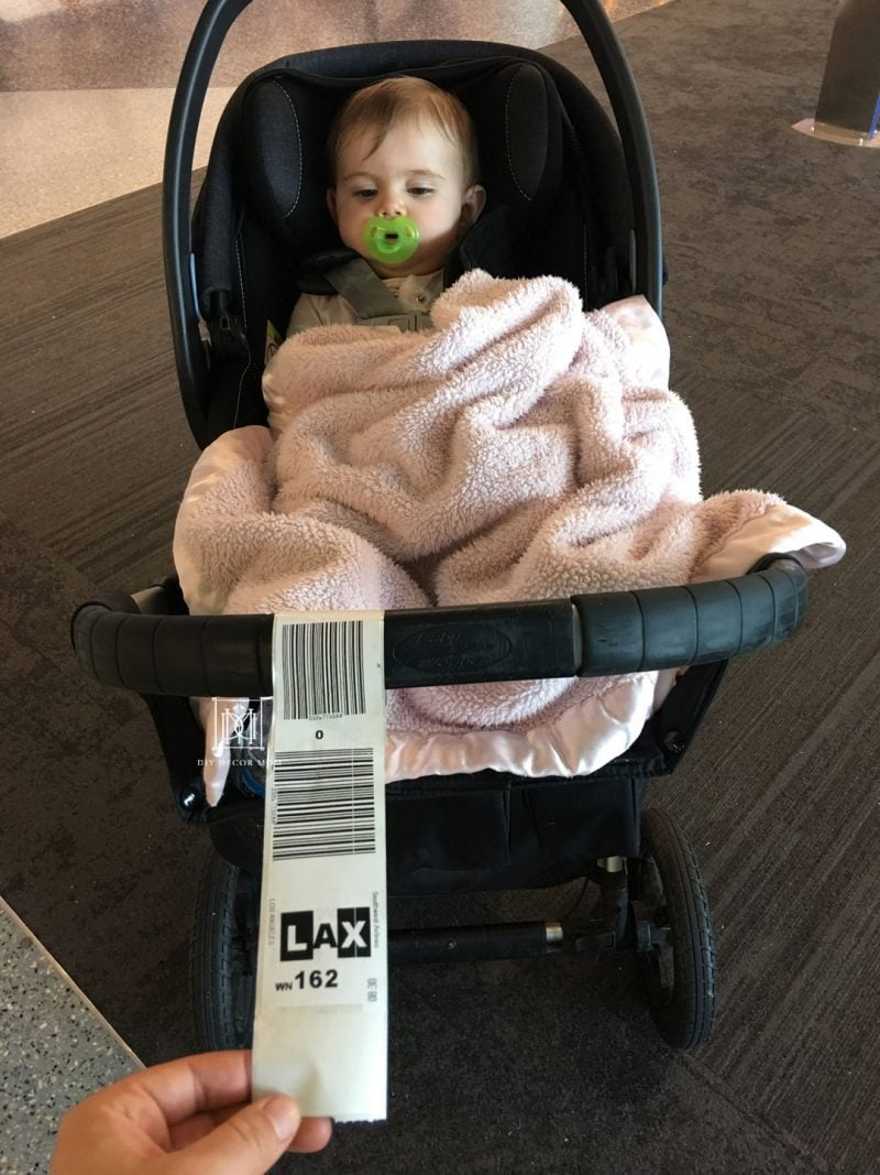 traveling with baby--picture of stroller with luggage tags