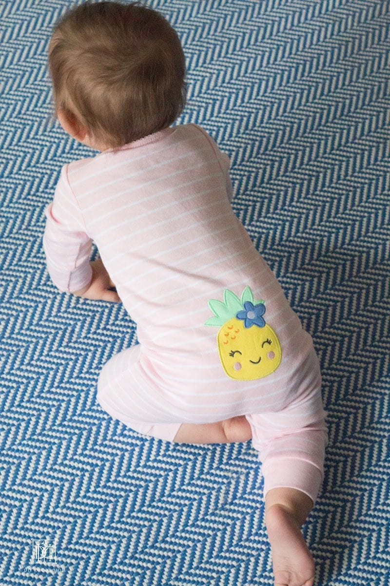 adorable pink onesie with pineapple on bottom of baby onesie