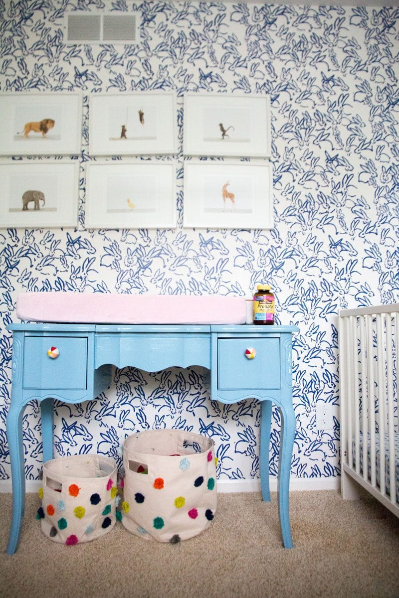 blue and white and pink nursery of what you need to buy before you have a baby