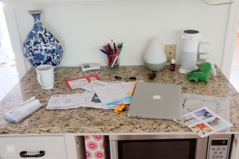 messy kitchen desk covered in papers