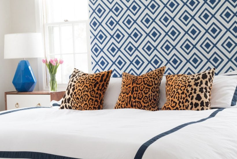 blue and white bedroom with blue and white headboard blue and white bedding and leopard throw pillows