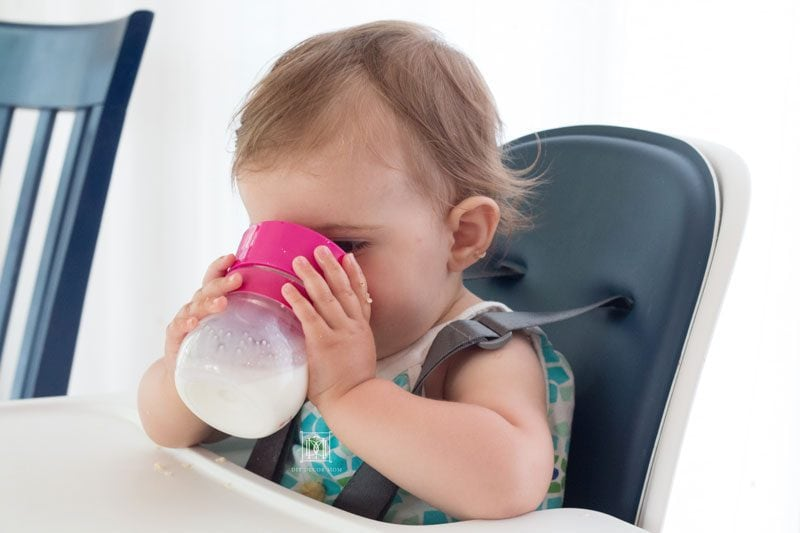 baby drinking out of sippy cup oxo transitions sippy cup
