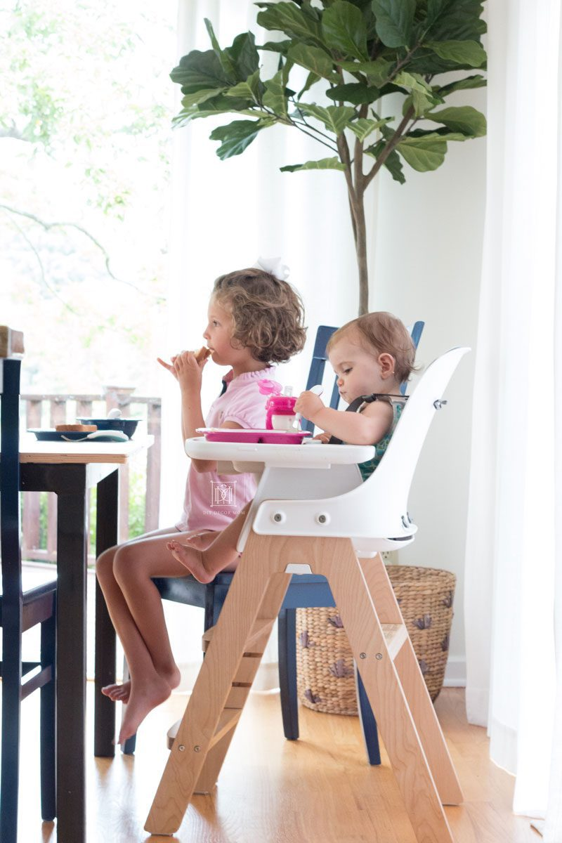 two girls sitting at a table- spring cleaning checklist and DIY recipes for cleaning dining chairs and high chairs