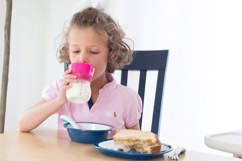 girl drinking from oxo transitions sippy cup