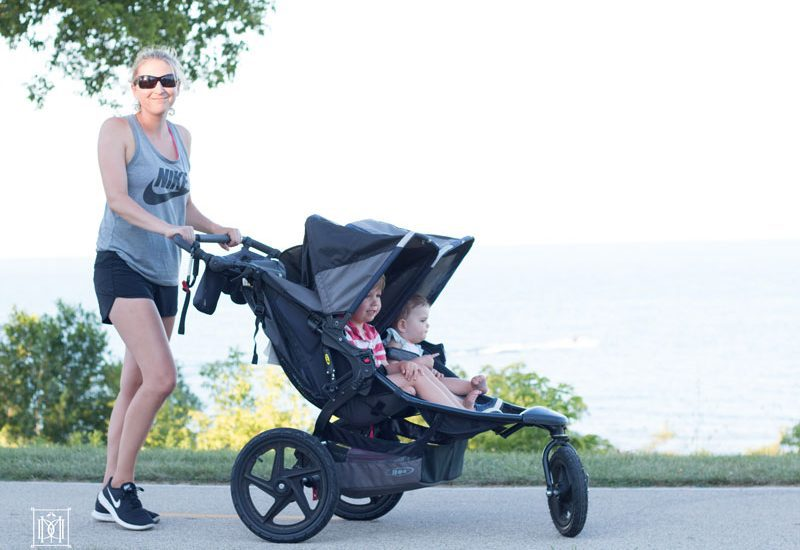 mom running with double jogging stroller= best double jogging stroller reviews