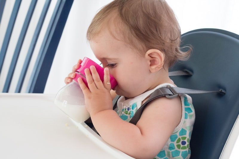 baby girl drinking sippy cup baby led weaning style
