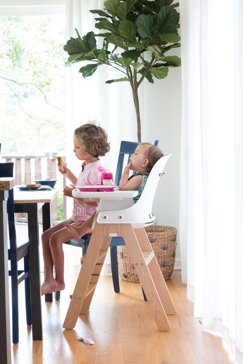 baby and girl baby eating at kitchen table baby led weaning style