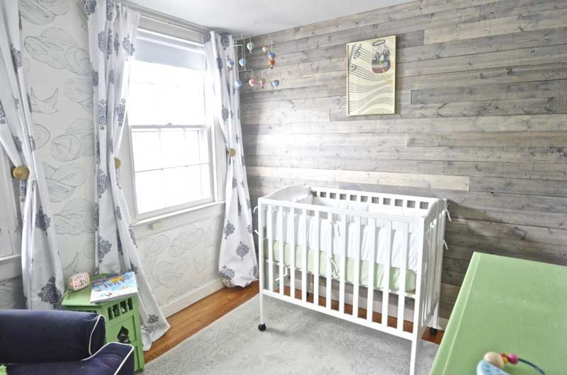 gender neutral nursery with pallet accent wall from At Charlotte's House- great boy nursery themes