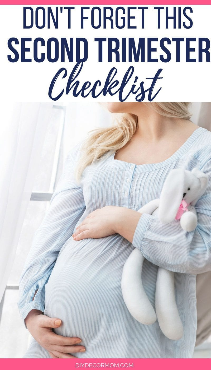 pregnant woman holding belly- second trimester things to do