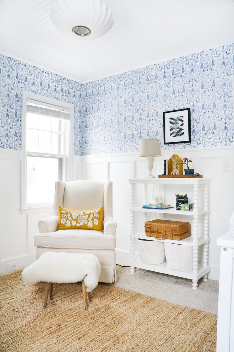 boy nursery ideas from Francois et Moi- board and batten in nursery with blue wallpaper and white rocking chair