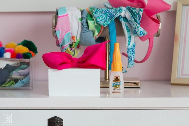 white diy ponytail holder on bookcase