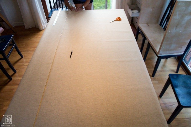 cut faux ostrich vinyl fabric on table
