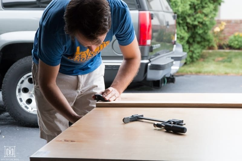 cutting a piece of plywood for diy console table