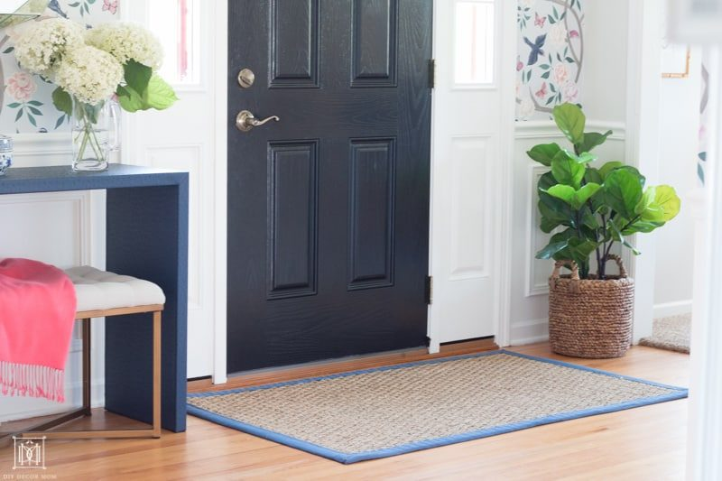 diy console table wrapped in blue fabric in entryway