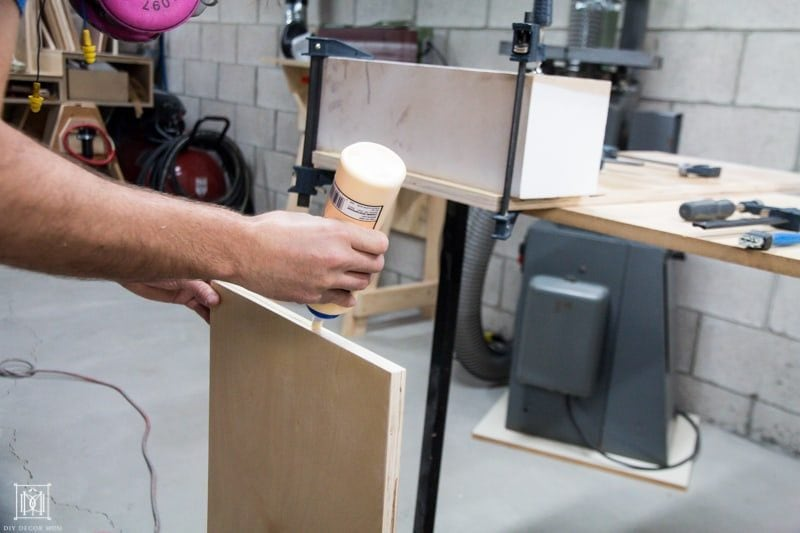 gluing pieces of plywood together for diy table