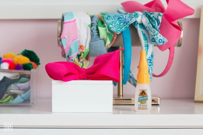 diy ponytail holder white box on a bookcase in girls bedroom