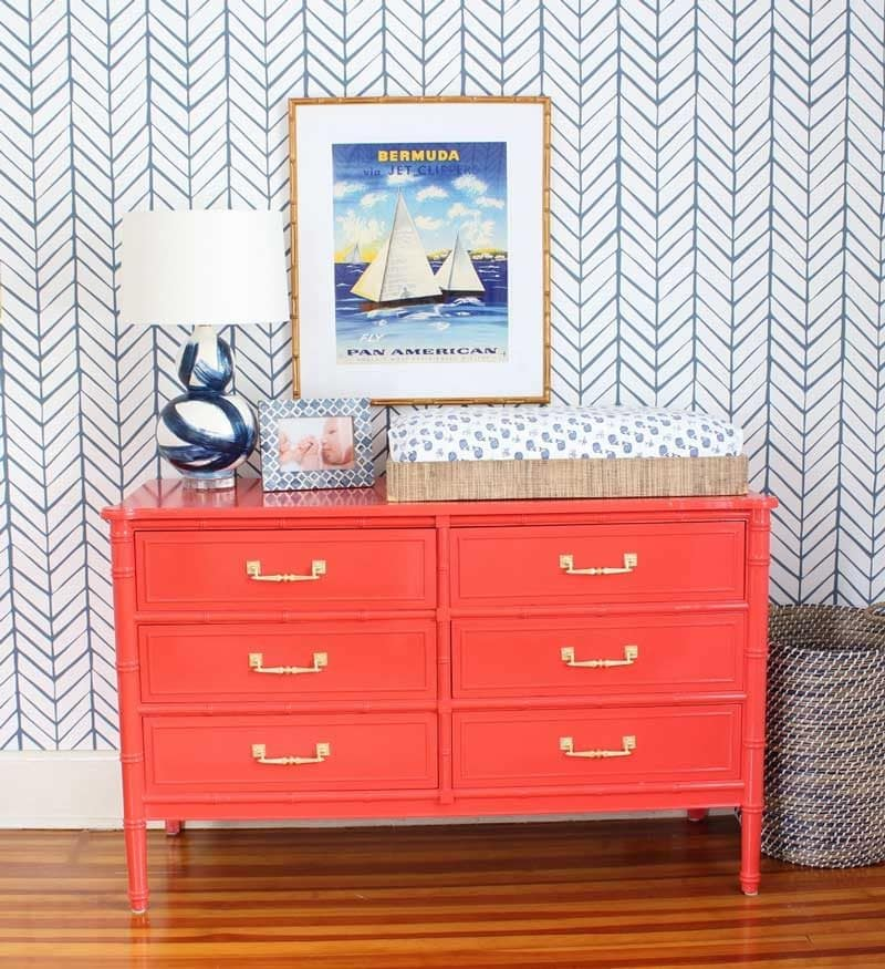 faux bamboo red dresser changing table and serena and lily wallpaper in nautical baby boy nursery- great nursery ideas from kate smith interiors