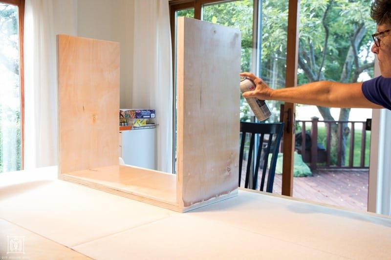 spray plywood diy console table with spray adhesive to secure fabric