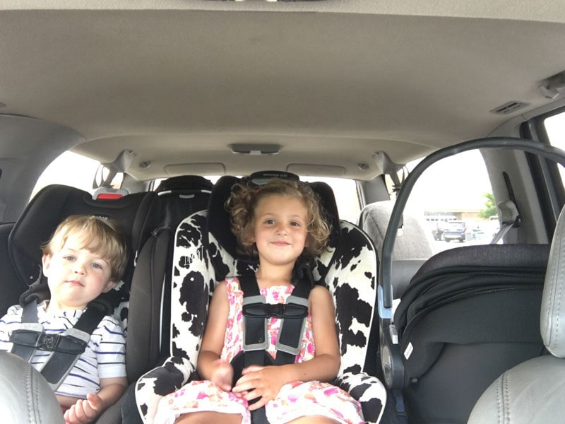 three kids in car seats- baby essentials for second time moms