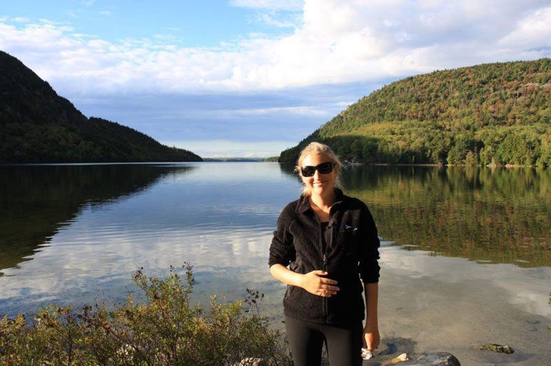 pregnant woman in acadia national park on babymoon