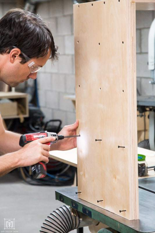 use screws to combine two pieces of plywood to make a plywood console table