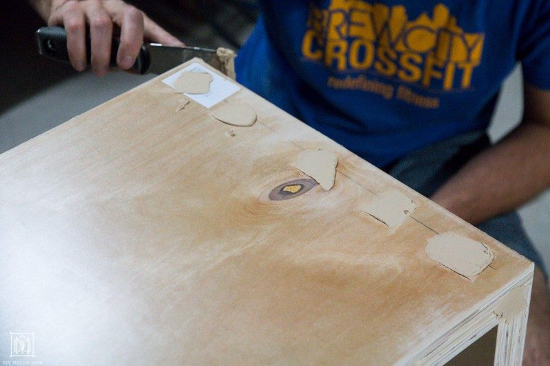 use wood putty to cover holes in plywood