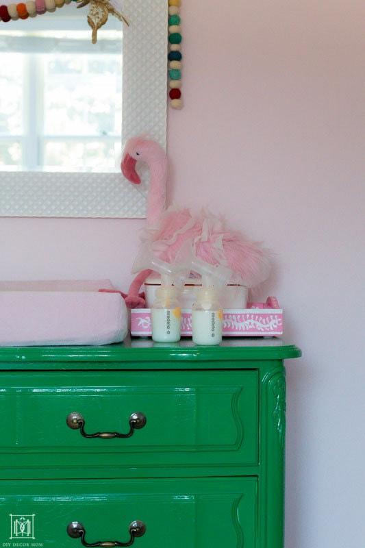 how to get a free breastpump- medela pump in style pumped breastmilk on green dresser