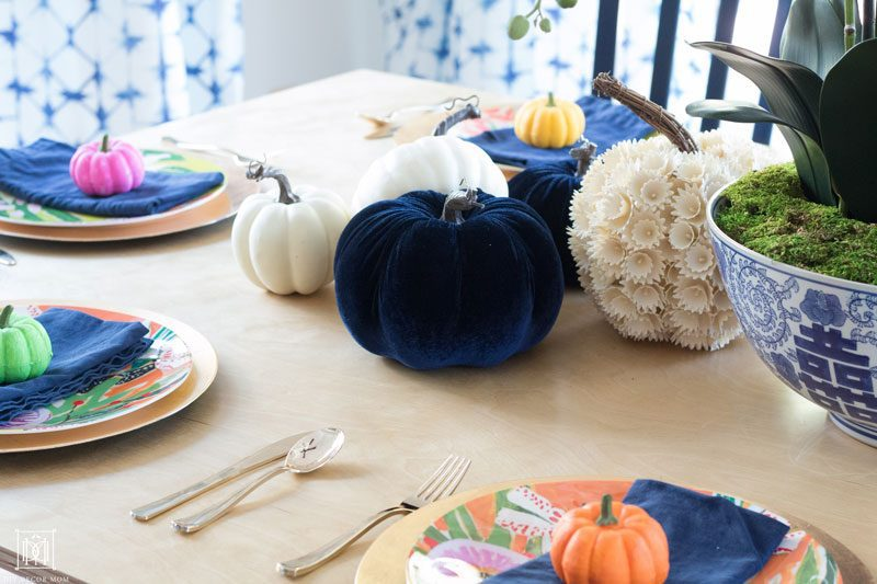 colorful pumpkin fall tablescape with blue and white fall decor ideas