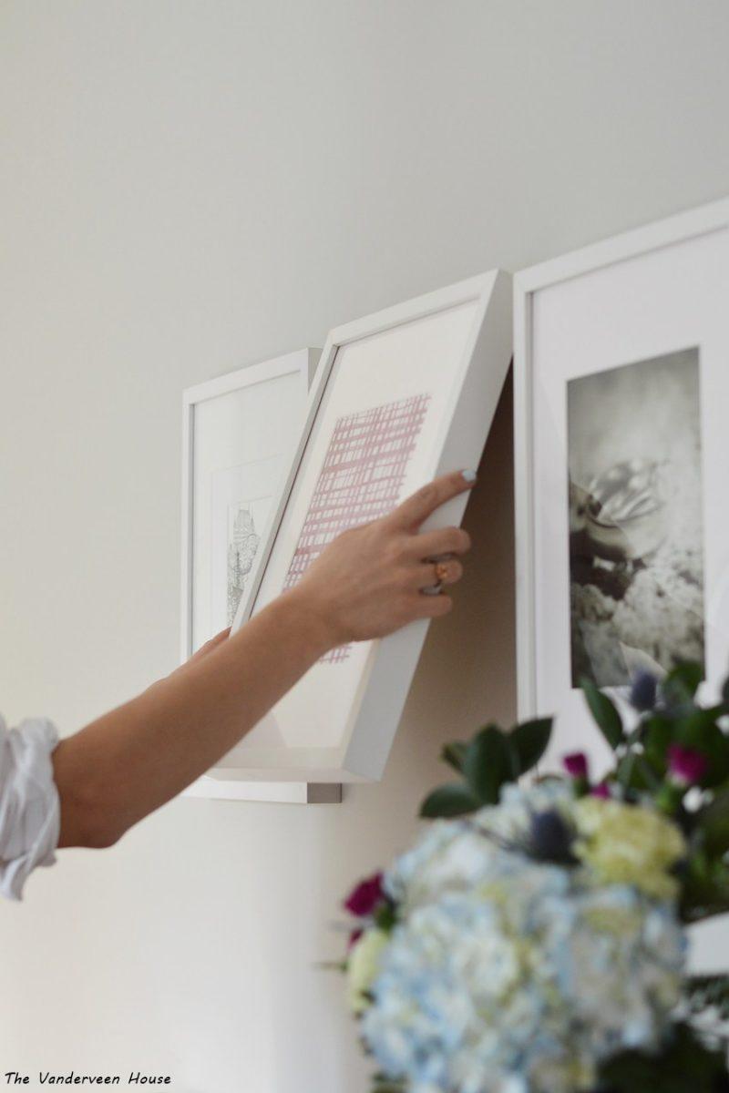 Gray Owl Benjamin Moore master bedroom hanging gallery wall frames