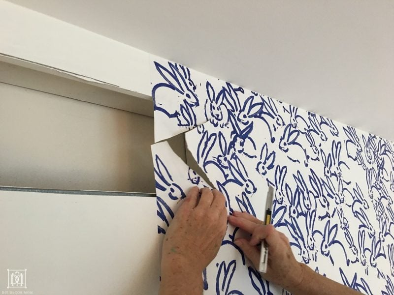 how to cut off excess wallpaper at vents and electrical outlets